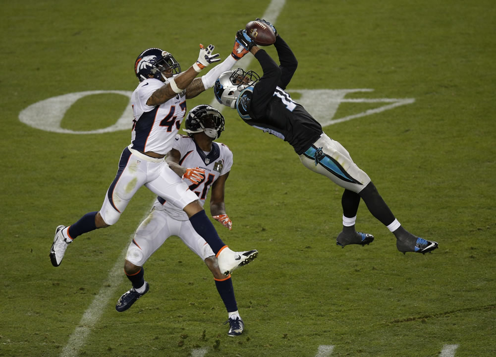 <div class='meta'><div class='origin-logo' data-origin='none'></div><span class='caption-text' data-credit='AP Photo/Charlie Riedel'>Carolina Panthers' Corey Brown (10) catches a pass in front of Denver Broncos' T.J. Ward (43) and Aqib Talib (21) during Super Bowl 50 on Feb. 7, 2016, in Santa Clara, Calif..</span></div>