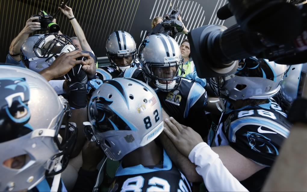 <div class='meta'><div class='origin-logo' data-origin='none'></div><span class='caption-text' data-credit='AP Photo/Gregory Bull'>Carolina Panthers' Cam Newton (1) huddles with teammates before the NFL Super Bowl 50 football game against the Denver Broncos Sunday, Feb. 7, 2016, in Santa Clara, Calif.</span></div>