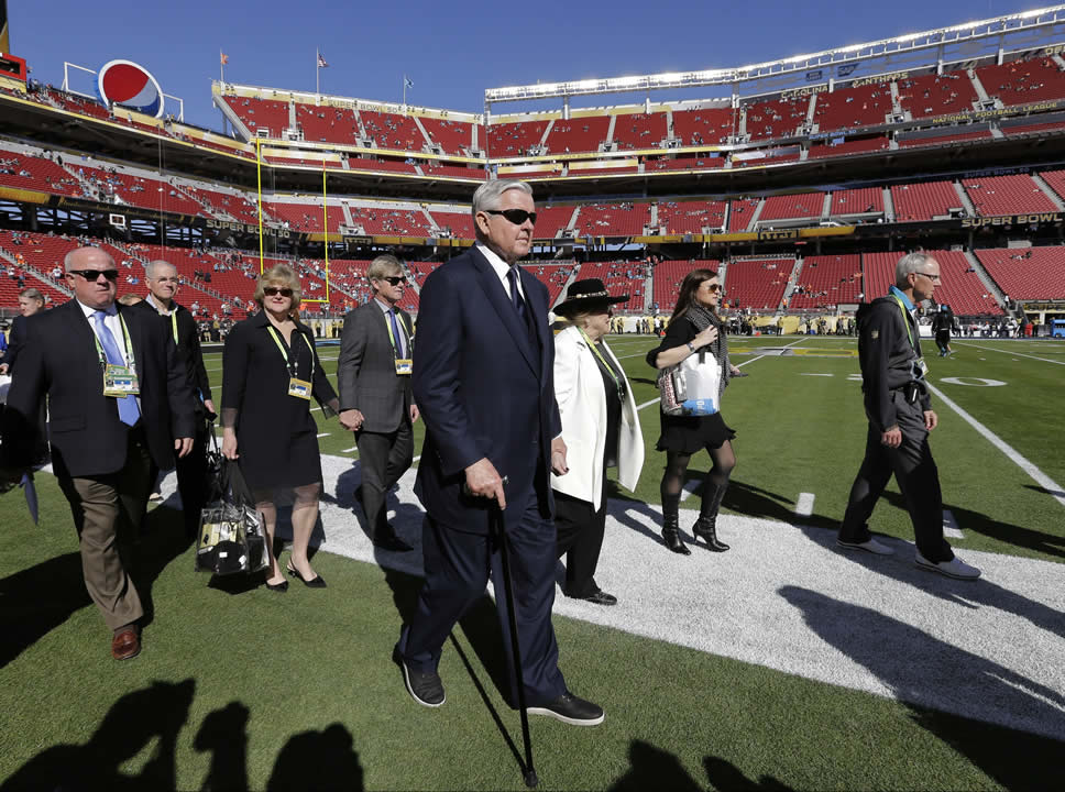 <div class='meta'><div class='origin-logo' data-origin='none'></div><span class='caption-text' data-credit='AP Photo/David J. Phillip'>Carolina Panthers owner Jerry Richardson, center, walks on the field before the NFL Super Bowl 50 football game Sunday, Feb. 7, 2016, in Santa Clara, Calif.</span></div>