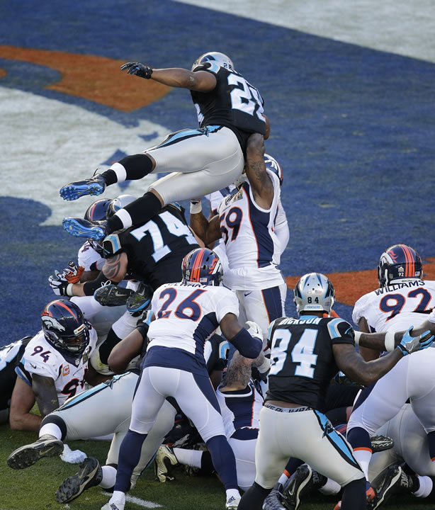 <div class='meta'><div class='origin-logo' data-origin='none'></div><span class='caption-text' data-credit='AP Photo/Charlie Riedel'>Panthers' Jonathan Stewart (28) leaps to the end zone for a touchdown against the Denver Broncos during the first half of the NFL Super Bowl 50 football game , Feb. 7, 2016.</span></div>