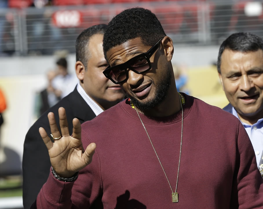"<div class=""meta image-caption""><div class=""origin-logo origin-image none""><span>none</span></div><span class=""caption-text"">Usher walks on the field before the NFL Super Bowl 50 football game Sunday, Feb. 7, 2016, in Santa Clara, Calif.  (AP Photo/David J. Phillip)</span></div>"