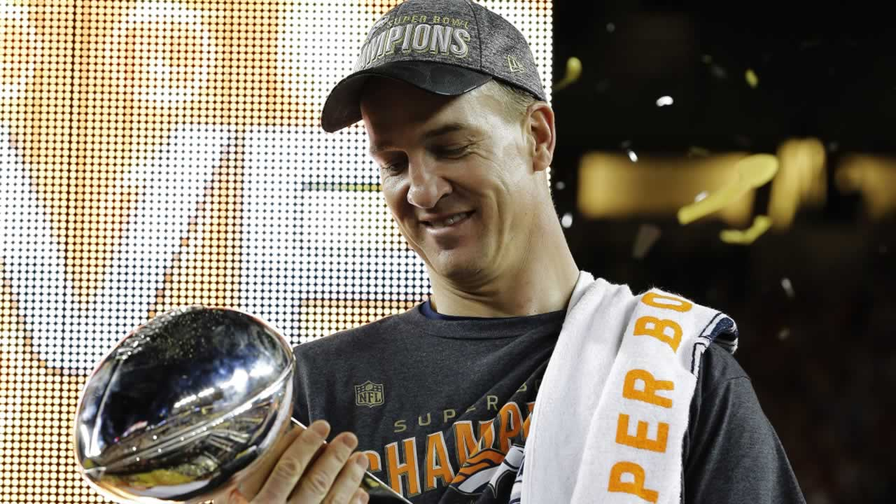 <div class='meta'><div class='origin-logo' data-origin='none'></div><span class='caption-text' data-credit='AP Photo/David J. Phillip'>Broncos' Peyton Manning holds up the trophy after the NFL Super Bowl 50 football game Sunday, Feb. 7, 2016, in Santa Clara, Calif.</span></div>