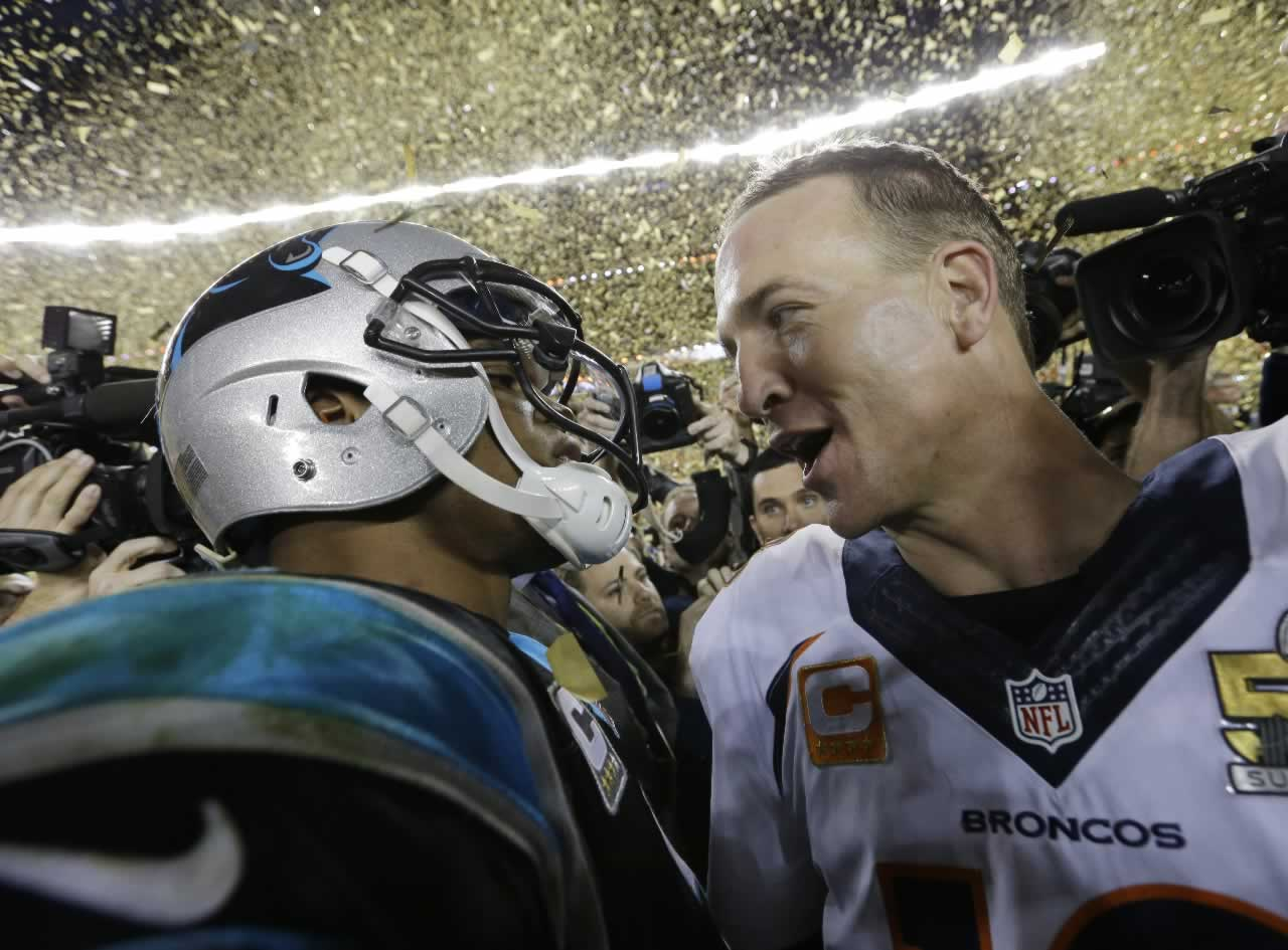 <div class='meta'><div class='origin-logo' data-origin='none'></div><span class='caption-text' data-credit='AP Photo/David J. Phillip'>Carolina Panthers' Cam Newton (1) talks to Denver Broncos' Peyton Manning (18) after the NFL Super Bowl 50 football game Sunday, Feb. 7, 2016, in Santa Clara, Calif.</span></div>