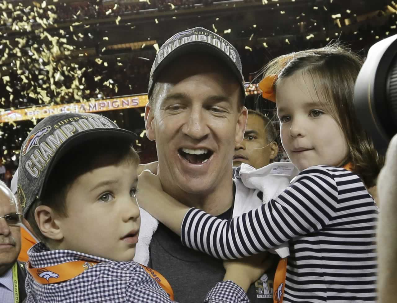 <div class='meta'><div class='origin-logo' data-origin='none'></div><span class='caption-text' data-credit='AP Photo/David J. Phillip'>Broncos' Peyton Manning celebrates with his son Marshall and daughter Mosley after the NFL Super Bowl 50 football game Sunday, Feb. 7, 2016, in Santa Clara, Calif.</span></div>