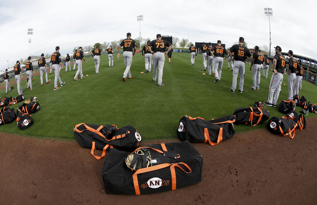 "<div class=""meta image-caption""><div class=""origin-logo origin-image none""><span>none</span></div><span class=""caption-text"">Members of the San Francisco Giants warm up before spring training baseball practice in Scottsdale, Ariz., Thursday, Feb. 18, 2016.  (AP Photo/Chris Carlson)</span></div>"