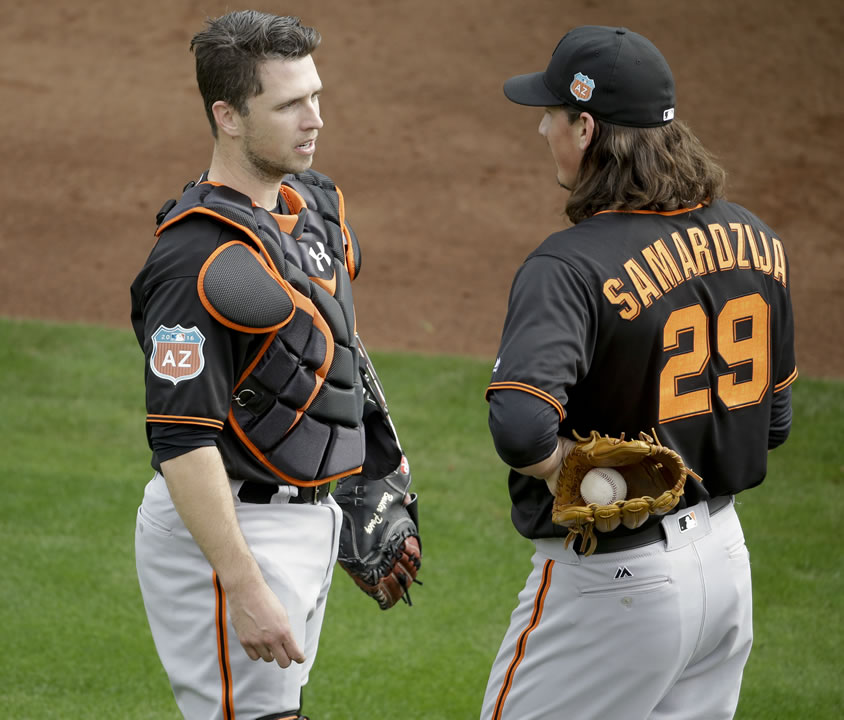 "<div class=""meta image-caption""><div class=""origin-logo origin-image none""><span>none</span></div><span class=""caption-text"">San Francisco Giants catcher Buster Posey, left, and starting pitcher Jeff Samardzija chat before the spring baseball season in Scottsdale, Ariz., Feb. 18, 2016.  (AP Photo/Chris Carlson)</span></div>"