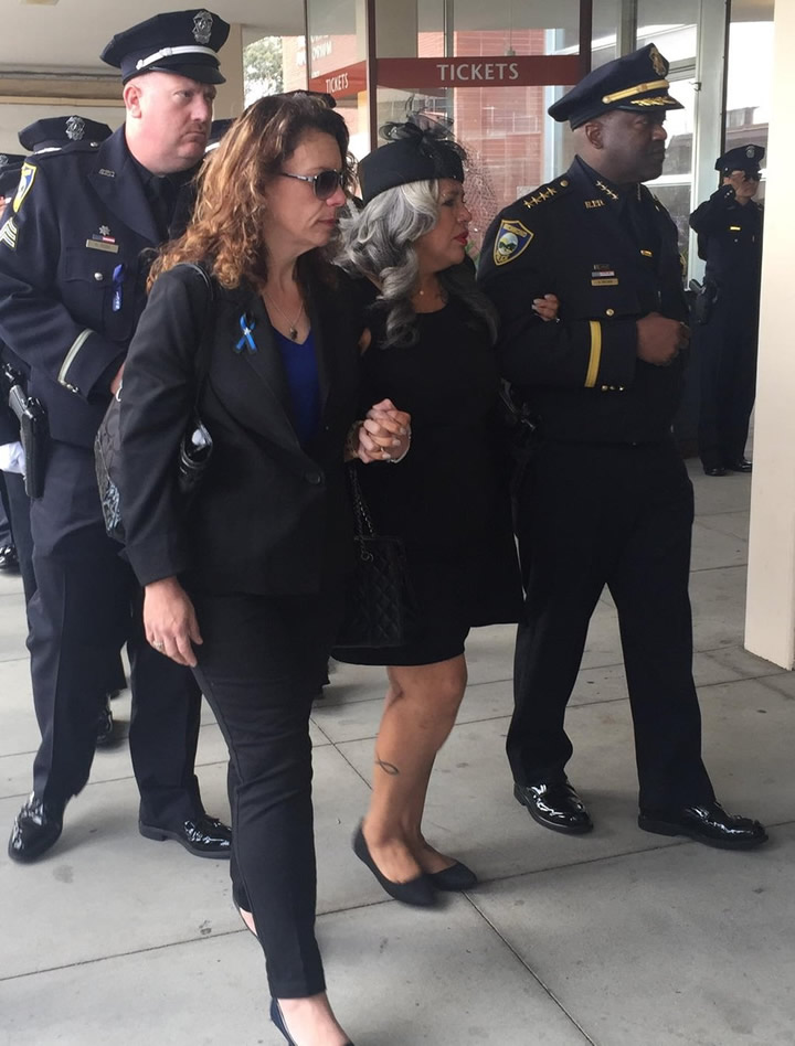 <div class='meta'><div class='origin-logo' data-origin='none'></div><span class='caption-text' data-credit='KGO-TV/Amy Hollyfield'>Officer Gus Vegas' wife, Sandra, walks into the public ahead of a public memorial for her husband at Skyview Memorial Lawn in Vallejo, Calif. on Friday, February 19, 2016.</span></div>