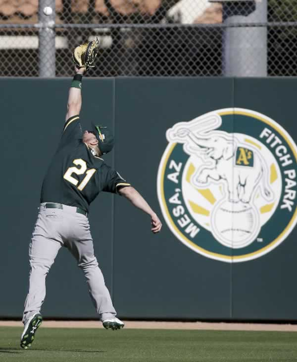 "<div class=""meta image-caption""><div class=""origin-logo origin-image none""><span>none</span></div><span class=""caption-text"">Oakland Athletics catcher Stephen Vogt catches balls during spring training baseball practice in Mesa, Ariz., Sunday, Feb. 21, 2016. (AP Photo/Chris Carlson)</span></div>"