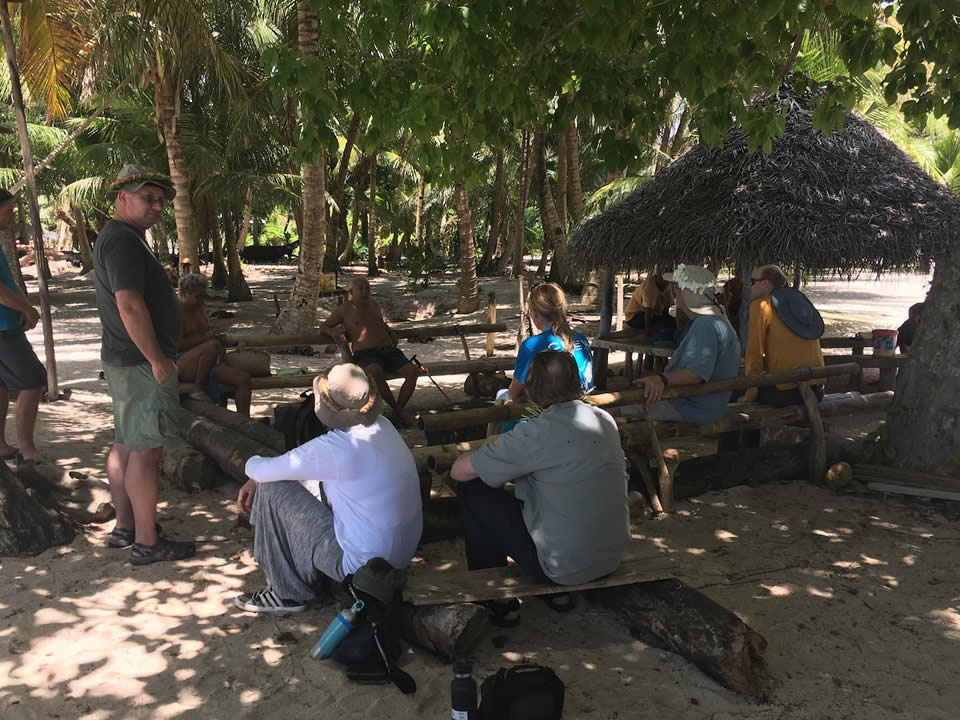 "<div class=""meta image-caption""><div class=""origin-logo origin-image none""><span>none</span></div><span class=""caption-text"">This image taken in March 2016 shows Exploratorium workers meeting with chiefs on the remote island of Woleai, a tiny atoll in Micronesia. (The Exploratorium)</span></div>"