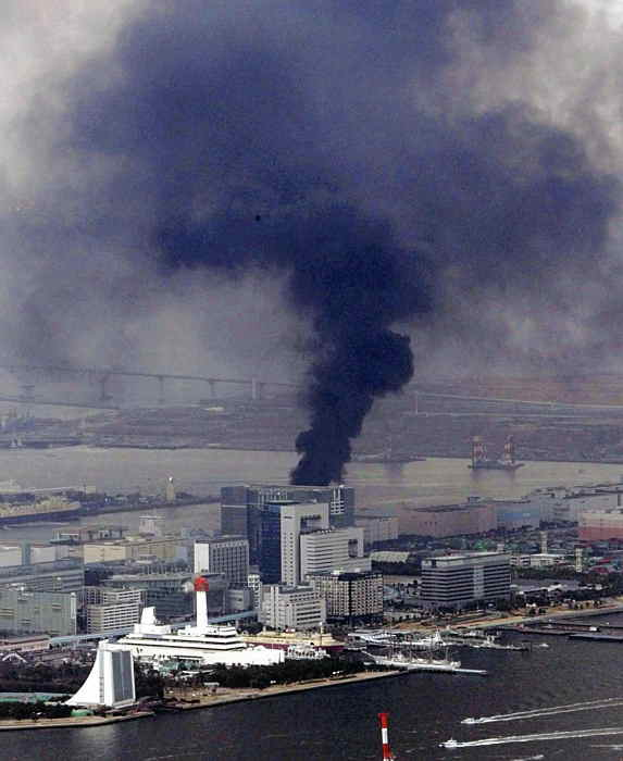 """<div class=""""meta image-caption""""><div class=""""origin-logo origin-image """"><span></span></div><span class=""""caption-text"""">Black smoke rises from a building in Tokyo's Odaiba bay area after strong earthquakes hit Japan Friday, March 11, 2011. (AP Photo/Yasushi Kanno, The Yomiuri Shimbun)</span></div>"""