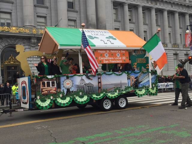 <div class='meta'><div class='origin-logo' data-origin='none'></div><span class='caption-text' data-credit='KGO-TV/Joann Hartmann'>A float passes by San Francisco City Hall during the St. Patrick's Day Parade in San Francisco, Calif., on Saturday, March 12, 2016.</span></div>