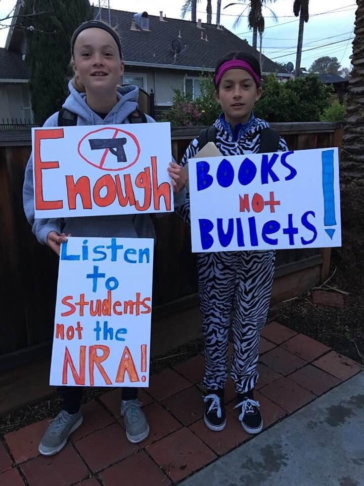 <div class='meta'><div class='origin-logo' data-origin='none'></div><span class='caption-text' data-credit='@sanjosetwingles/Twitter'>Two girls are seen holding signs in front of a school in San Jose, Calif. on Wednesday, March <br>14, 2018 during a walkout in response to gun violence.</span></div>