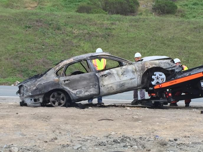 """<div class=""""meta image-caption""""><div class=""""origin-logo origin-image none""""><span>none</span></div><span class=""""caption-text"""">The car that caught fire on the eastbound bore of the Caldecott Tunnel Monday morning, Mar. 16, 2015.  Dozens of people fled from their vehicles on foot. ((KGO-TV/Amy Hollyfield))</span></div>"""