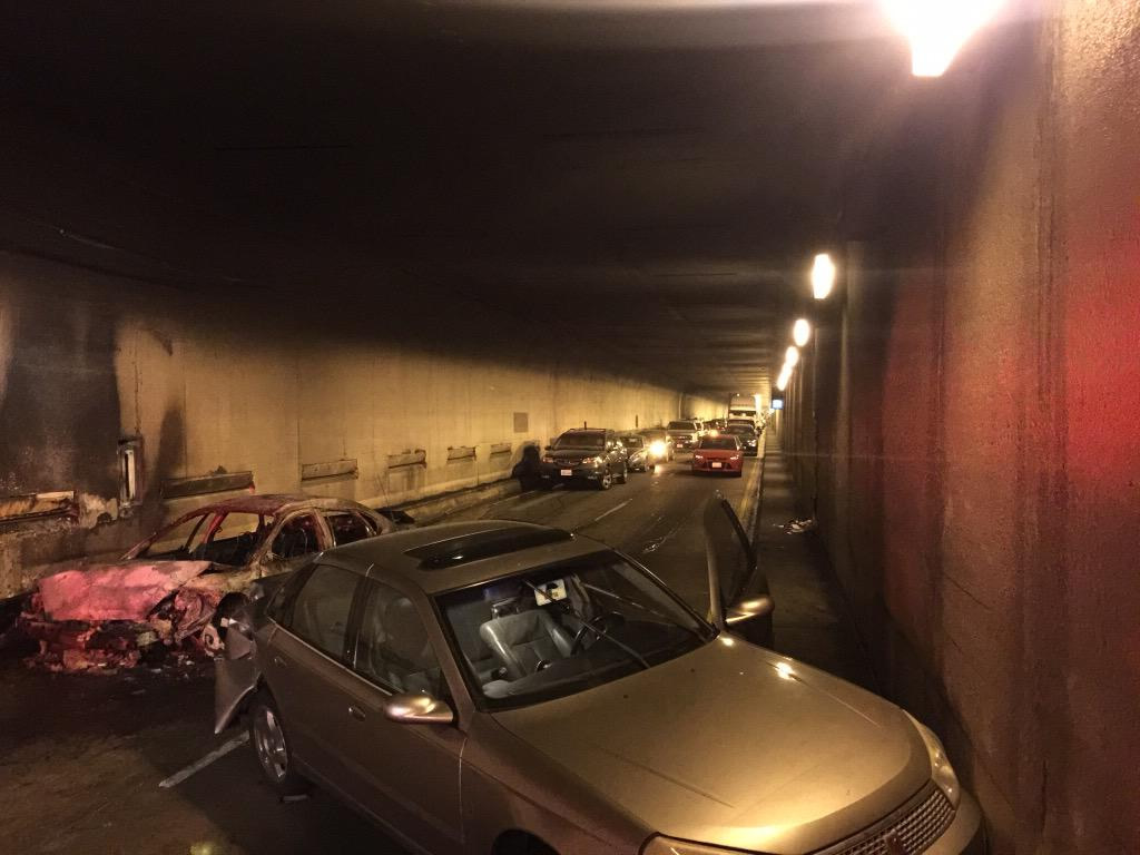 """<div class=""""meta image-caption""""><div class=""""origin-logo origin-image none""""><span>none</span></div><span class=""""caption-text"""">A car caught fire on the eastbound bore of the Caldecott Tunnel Monday morning, Mar. 16, 2015.  Dozens of people fled from their vehicles on foot. ((Twitter/@Oaklandfirelive) )</span></div>"""