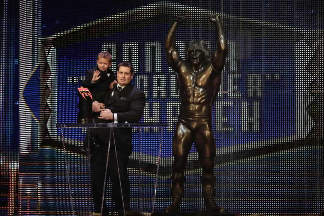 """<div class=""""meta image-caption""""><div class=""""origin-logo origin-image none""""><span>none</span></div><span class=""""caption-text"""">The dad of the late Connor """"The Crusher"""" Michalek holds his son Jackson, as he accepts an award in honor of Connor at the WWE Hall of Fame on March 28, 2015 in San Jose, Calif.  (Don Feria/AP Images for WWE)</span></div>"""