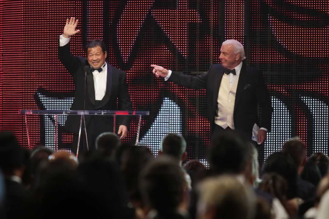 """<div class=""""meta image-caption""""><div class=""""origin-logo origin-image none""""><span>none</span></div><span class=""""caption-text"""">Inductee Tatsumi Fujinami, left, is introduced by Ric Flair at the WWE Hall of Fame Ceremony, on Saturday, March 28, 2015 in San Jose, Calif. (Don Feria/AP Images for WWE)</span></div>"""