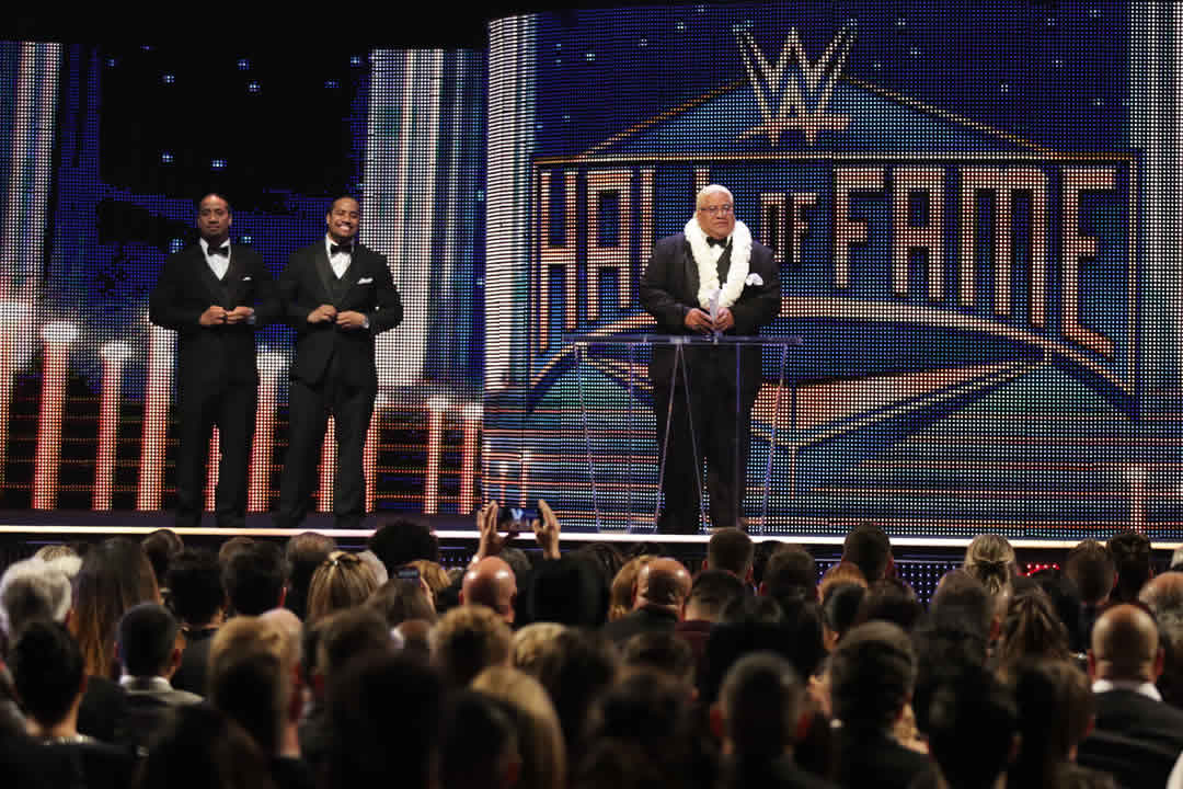 """<div class=""""meta image-caption""""><div class=""""origin-logo origin-image none""""><span>none</span></div><span class=""""caption-text"""">Inductee Rikishi accepts his award with his sons, Jimmy and Jey Uso at the WWE Hall of Fame Ceremony, on Saturday, March 28, 2015 in San Jose, Calif. (Don Feria/AP Images for WWE) </span></div>"""