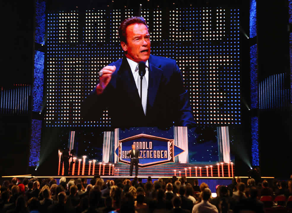 """<div class=""""meta image-caption""""><div class=""""origin-logo origin-image none""""><span>none</span></div><span class=""""caption-text"""">Inductee Arnold Schwarzenegger greets the crowd at the WWE Hall of Fame Ceremony, on Saturday, March 28, 2015 in San Jose, Calif. (Don Feria/AP Images for WWE)</span></div>"""