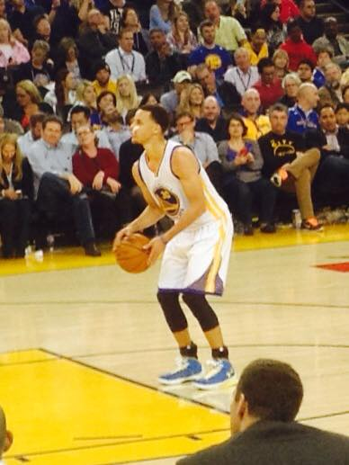 <div class='meta'><div class='origin-logo' data-origin='none'></div><span class='caption-text' data-credit='Photo submitted by Kim/Facebook'>Golden State Warriors fan Kim took this picture showing Dubs star Steph Curry about to take a shot. Send your fan photos to uReport@kgo-tv.com!</span></div>