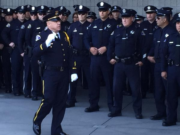 <div class='meta'><div class='origin-logo' data-origin='KGO'></div><span class='caption-text' data-credit=''>Officers with the San Jose police department attend the funeral service for Officer Michael Johnson at the SAP Center on Thursday, April 2, 2105. (KGO-TV)</span></div>