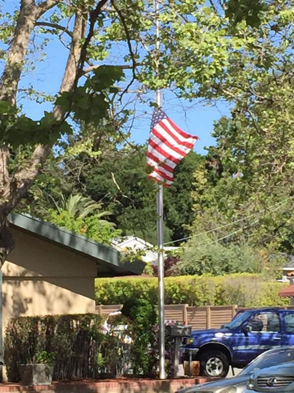 <div class='meta'><div class='origin-logo' data-origin='KGO'></div><span class='caption-text' data-credit=''>The flag flying at half staff outside the Darling Fischer Funeral Home in Los Gatos where Officer Johnson's procession began on Thursday, April 2, 2015. (KGO-TV)</span></div>