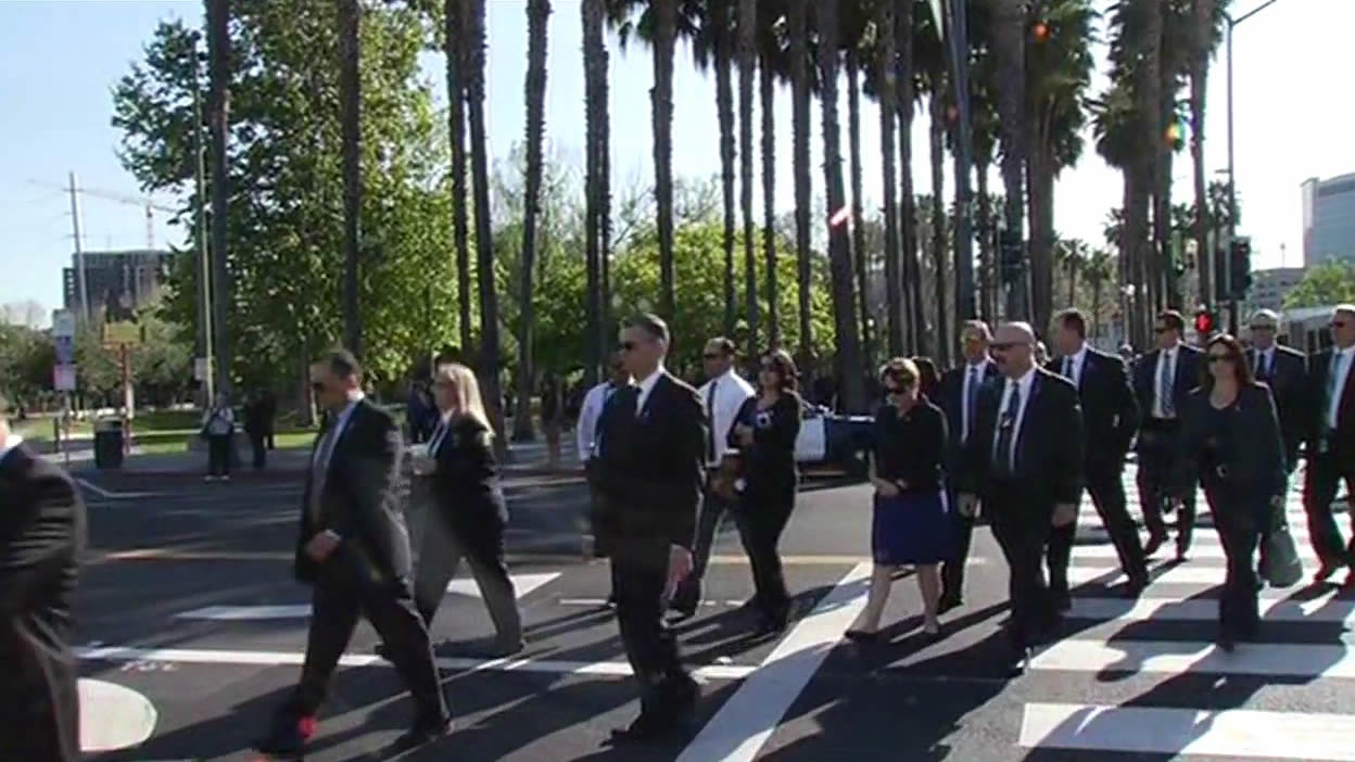 <div class='meta'><div class='origin-logo' data-origin='KGO'></div><span class='caption-text' data-credit='Guests arrive'>Guests arrive at the SAP Center for the memorial service for SJPD Officer Michael Johnson on Thursday, April 2, 2015. (KGO-TV)</span></div>
