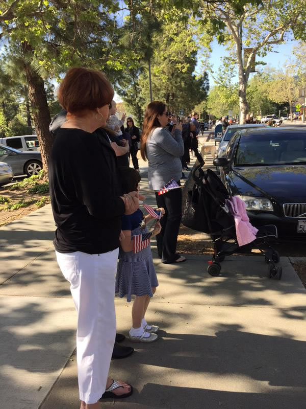 <div class='meta'><div class='origin-logo' data-origin='KGO'></div><span class='caption-text' data-credit=''>Families await the start of the funeral procession for SJPD Officer Michael Johnson on Thursday, April 2, 2015. (KGO-TV)</span></div>