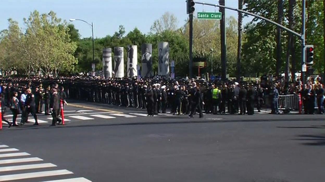 <div class='meta'><div class='origin-logo' data-origin='KGO'></div><span class='caption-text' data-credit=''>Hundreds of San Jose police officers lining up outside the SAP Center on Thursday, April 2, 2015. (KGO-TV)</span></div>