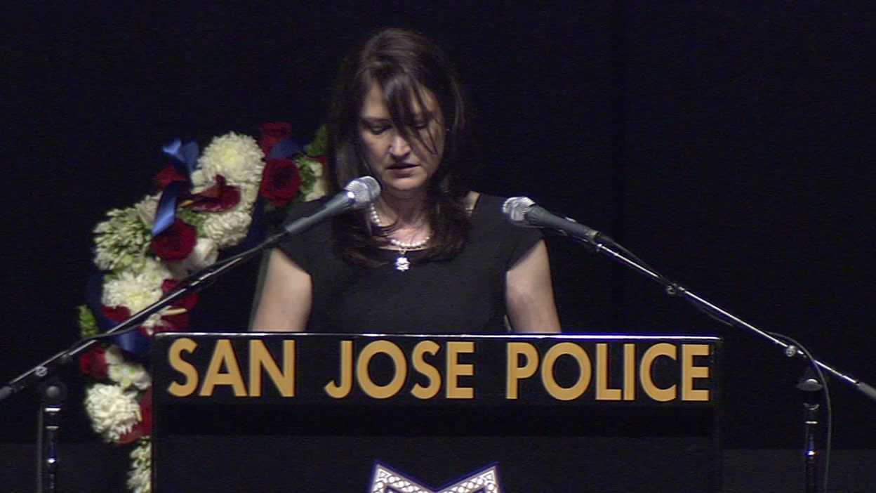 <div class='meta'><div class='origin-logo' data-origin='KGO'></div><span class='caption-text' data-credit=''>Jamie Radack remembers her brother, Officer Michael Johnson, at his memorial service on Thursday, April 2, 2105. (KGO-TV)</span></div>