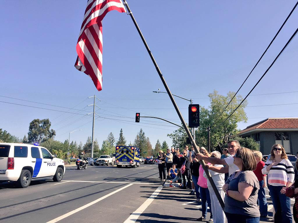 <div class='meta'><div class='origin-logo' data-origin='KGO'></div><span class='caption-text' data-credit=''>Scenes from the procession as it left Los Gatos en route to the SAP Center for the memorial service for SJPD officer Michael Johnson on Thursday, April 2, 2105. (KGO-TV)</span></div>