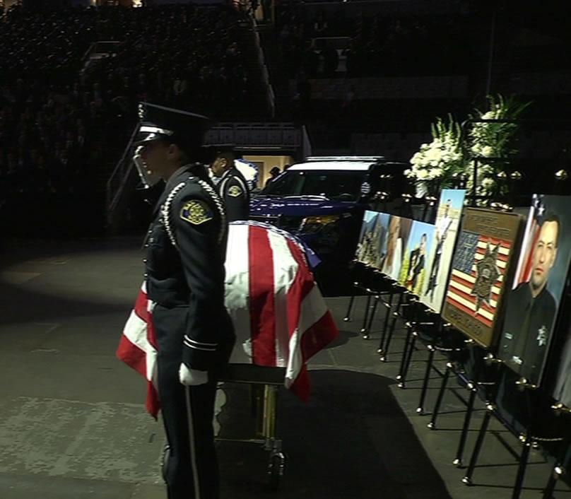 <div class='meta'><div class='origin-logo' data-origin='KGO'></div><span class='caption-text' data-credit='KGO-TV'>Officers salute fallen SJPD Officer Michael Johnson at his memorial service in San Jose on Thursday, April 2, 2015.</span></div>