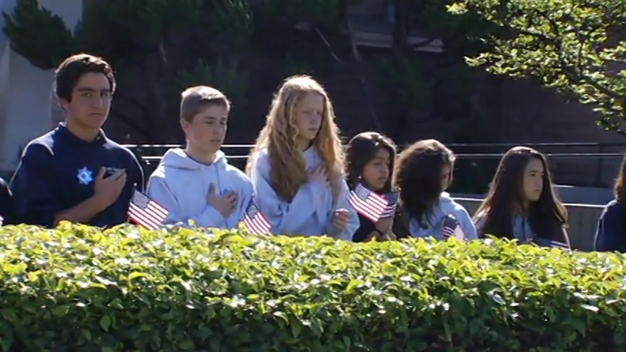 <div class='meta'><div class='origin-logo' data-origin='KGO'></div><span class='caption-text' data-credit=''>Students from St. Lucy Parish School in Campbell line the streets as the Hearst of SJPD Officer Michael Johnson passes by on Thursday, April 2, 2015. (KGO-TV)</span></div>