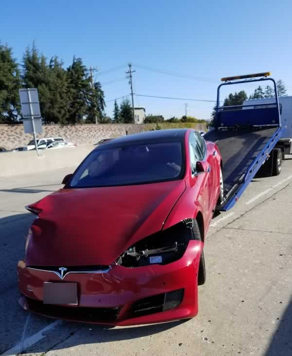 <div class='meta'><div class='origin-logo' data-origin='none'></div><span class='caption-text' data-credit='KGO-TV'>This photo was taken from the scene of a crash involving a Tesla on autopilot in Hayward, Calif. in September 2017.</span></div>