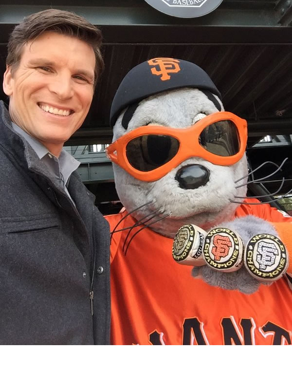<div class='meta'><div class='origin-logo' data-origin='none'></div><span class='caption-text' data-credit='KGO-TV/ Matt Keller'>ABC7 News reporter Matt Keller poses with Lou Seal at the San Francisco Giants home opener at AT&T Park April 7, 2016.</span></div>