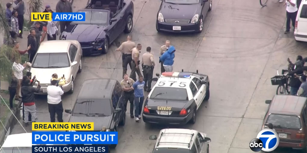 <div class='meta'><div class='origin-logo' data-origin='KABC'></div><span class='caption-text' data-credit=''>Two burglary suspects in a Ford Mustang led police on a chase through Los Angeles before pulling over to the side and waiting to be arrested on Thursday, April 7, 2016.</span></div>