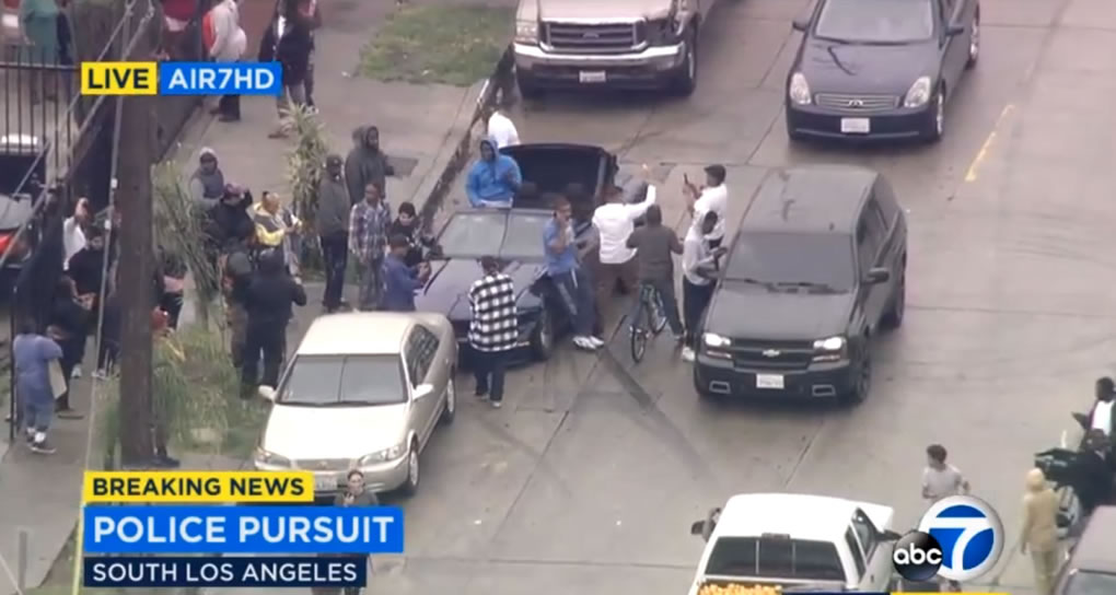 <div class='meta'><div class='origin-logo' data-origin='KABC'></div><span class='caption-text' data-credit=''>Burglary suspects in a Ford Mustang led police on a chase through Los Angeles on Thursday, April 7, 2016. They eventually stopped to wait for cops and took selfies with bystanders.</span></div>