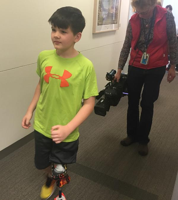 "<div class=""meta image-caption""><div class=""origin-logo origin-image none""><span>none</span></div><span class=""caption-text"">Chris Formaker is seen walking using a prosthetic leg in the hallway of Lucile Packard Children's Hospital Stanford in this undated image. (Photo submitted to KGO-TV by the Formaker family)</span></div>"