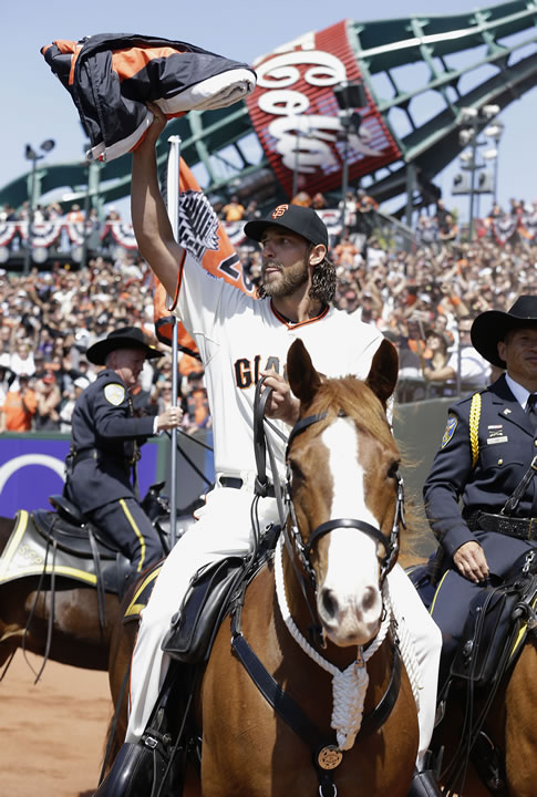 "<div class=""meta image-caption""><div class=""origin-logo origin-image none""><span>none</span></div><span class=""caption-text"">San Francisco Giants pitcher Madison Bumgarner carries the 2014 Giants championship pennant while riding a police horse before a game in San Francisco, April 13, 2015. (AP Photo/Jeff Chiu, Pool)</span></div>"