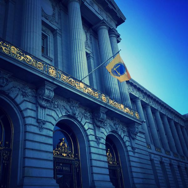 <div class='meta'><div class='origin-logo' data-origin='none'></div><span class='caption-text' data-credit=''>A Warriors flag hangs outside Oakland's City Hall. Photo submitted by @FTinSF)</span></div>