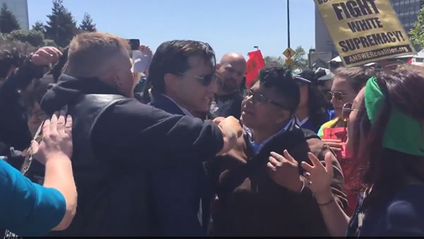 <div class='meta'><div class='origin-logo' data-origin='none'></div><span class='caption-text' data-credit='KGO-TV'>Protesters hold back a Republican supporter from getting in the Hyatt Regency in Burlingame, Calif., where Trump is set to speak on Friday, April 29, 2016</span></div>