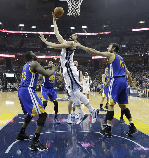 <div class='meta'><div class='origin-logo' data-origin='none'></div><span class='caption-text' data-credit=''>Grizzlies' Marc Gasol shoots between Warriors' Draymond Green in Game 3 of the NBA basketball Western Conference playoffs on May 9, 2015, in Memphis, Tenn. (AP Photo)</span></div>