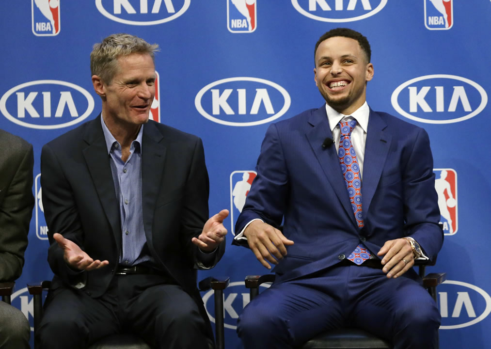 <div class='meta'><div class='origin-logo' data-origin='none'></div><span class='caption-text' data-credit='AP Photo/Ben Margot'>Golden State Warriors guard Stephen Curry smiles alongside head coach Steve Kerr during the NBA's Most Valuable Player award presentation on May 10, 2016, in Oakland, Calif.</span></div>