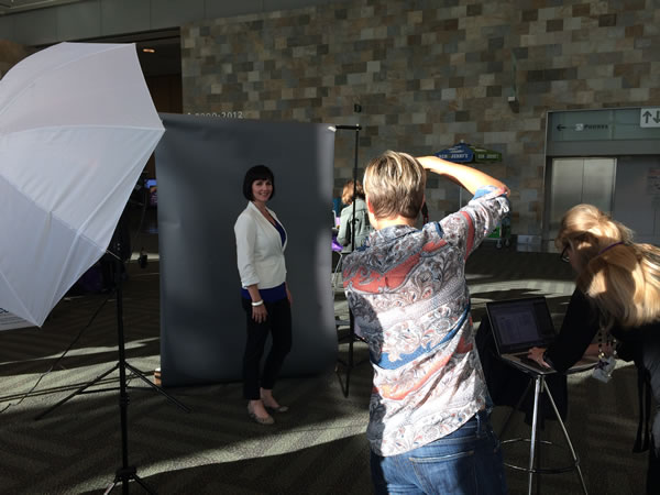 Conference attendees could have professional headshots taken. <span class=meta>(KGO)</span>