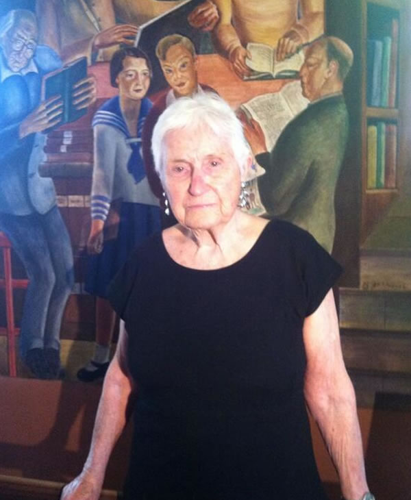 "<div class=""meta ""><span class=""caption-text "">This 91 year old is the 12 year old in the sailor suit-depicted in her dad's now mural at Coit Tower. (Carolyn Tyler)</span></div>"