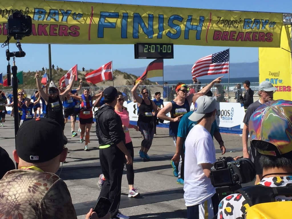 <div class='meta'><div class='origin-logo' data-origin='none'></div><span class='caption-text' data-credit='KGO-TV'>Racers cross the finish line in the Bay to Breakers race in San Francisco on Sunday, May 15, 2106.</span></div>