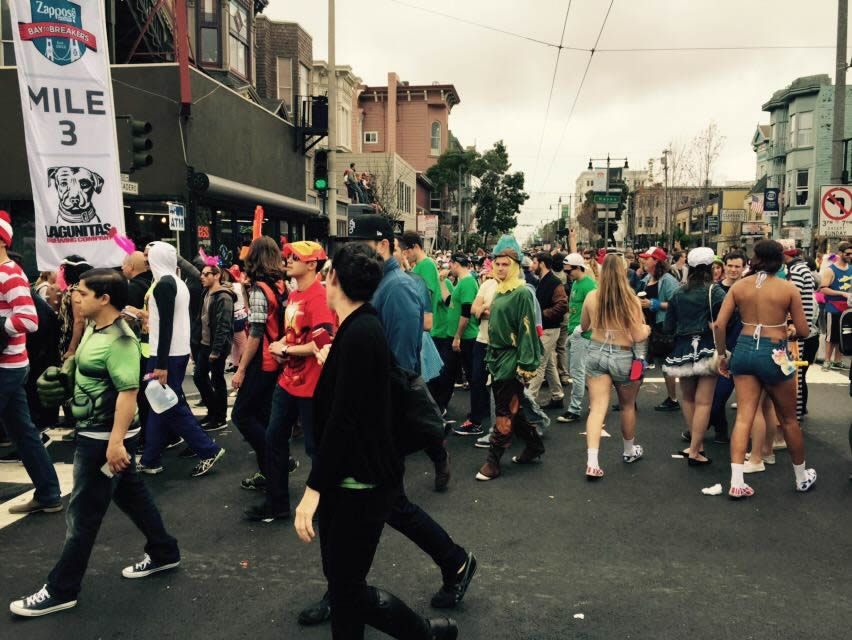 <div class='meta'><div class='origin-logo' data-origin='none'></div><span class='caption-text' data-credit='KGO-TV/Cornell Barnard'>At the mile 3 marker for San Francisco's annual Bay to Breakers on May 17, 2015, the race turned into a party.</span></div>