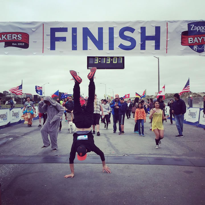<div class='meta'><div class='origin-logo' data-origin='none'></div><span class='caption-text' data-credit='Photo submitted to KGO-TV by Pearl W./Twitter'>A runner does a victory handstand after crossing the finish line of San Francisco's annual Bay to Breakers Race on May 17, 2015.</span></div>