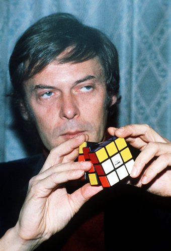 "Erno Rubik, a Professor at the Colleges of Applied Science at Budapest University, pictured in London, Dec. 10, 1981 with his ""Rubik Cube"". (AP-Photo/John Glanvill)"
