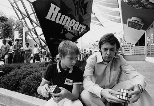 Eleven year old Jay Brandon of Knoxville, Tenn. gets some advise on Monday, August 16, 1982 from Erno Rubik. (AP Photo/Cindy Waters)