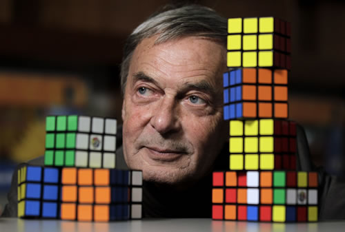 Erno Rubik, the inventor of the Rubik's Cube, poses for The Associated Press at Liberty Science Center, Wednesday, April 25, 2012, in Jersey City, N.J. (AP Photo/Julio Cortez)